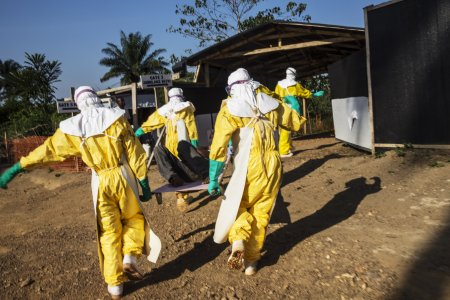 Doctors carry a patient infected by ebola