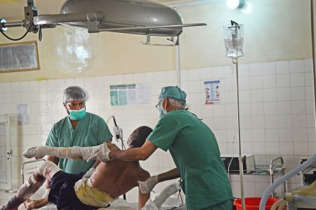 Medical staff prepare a 20-year-old Afghani man for surgery at the MSF supported hospital in Boost, Lashka Ghar, Afghanistan.