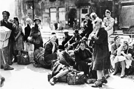 Refugees wait for transport, Berlin, June 1945.