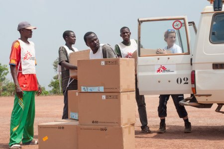 MSF logistician Jennifer Bock and her colleagues unload 58 boxes one ton of medical supplies, mainly malaria testing kits, destined for the MSF-supported health centre in Boguila.