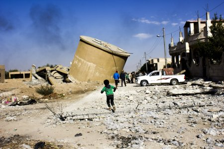 Residents of Al Mishlab, Raqqa returning back home to check their houses and belongings. The houses in Mishlab that still stand are scorched and reduced to piles of rubble, and the streets are full of rubbish and abandoned belongings: cooking pans, broken children's toys and documents. Shops are burned and looted, and the empty bullet cases underfoot are an indication of the violence of this war.