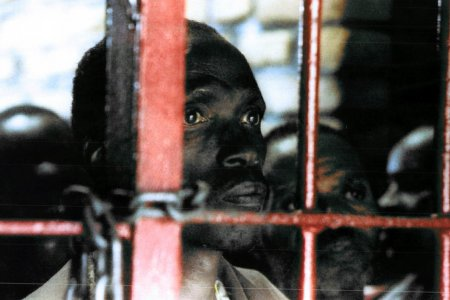 One of more than 7.000 mostly Hutu inmates at the overcrowded Gitarama prison stares out from behind the bars. Some 120 inmates were transferred by the UN in an effort to try to relieve overcrowding.